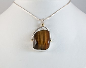 Tiger eye pendant sterling silver, twisted silver wire and brass details, on fox tail style chain
