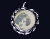 Antique sterling silver double-sided pendant with tin-type portraits of two women