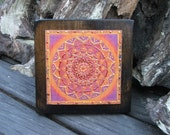 Mandala in orange color little picture on old wood