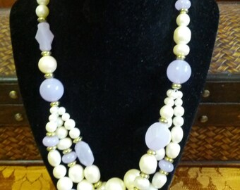 Beautiful faux pearl and lavender glass beaded necklace with gold tone spacers.