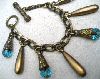 Dangling Brass Bracelet - Blue Tibetan Beads