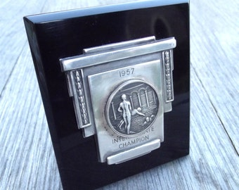 Deco style silver colour metal presentation swimming medal/trophy mounted on polished black Perspex/Phenol Resin plaque/stand. Dated 1957