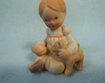 Vintage Holly Hobbies Friend-Heather-Ceramic Figurine-Playing With Her Puppy-Marked H Hobbie On Bottom