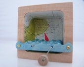 Kinetic Wooden Boat Sculpture with Nautical Charts