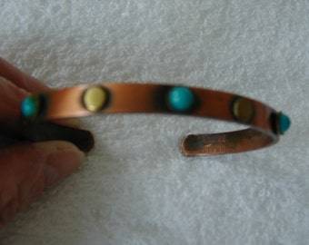 Very nice copper bracelet with tiny brass and turquoise colored accents