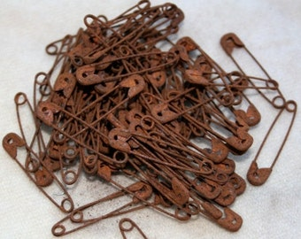 """25 Rusty Safety Pins -  just under 1.50"""" in length"""