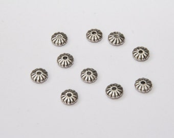 25 Pcs. metal beads / spacer in flower shape 4x8mm MP123