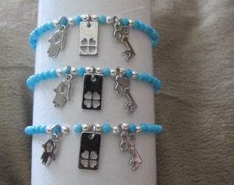 Turquoise bracelet with 3 charms