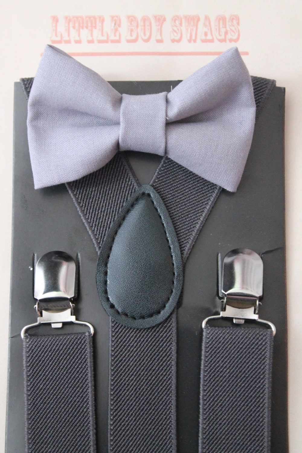 Grey or Gray Bow Ties - Men who have the fortune of having their hair turn silvery can make the most of it by grabbing gray bowties and wearing them together with an appropriate suit on all formal occasions. But grey bowties are not limited to men with silvery hair. They also go well with a whole range of suits, from white, to argent, to black.