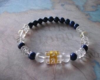 Carved (om ) quartz & lapis lazuli bracelet