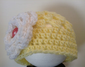 Crochet yellow hat with white flower and pink button center 0-3 months