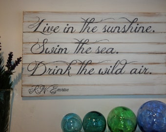 """Coastal chic sign:  """"Live in the sunshine, swim the sea, drink the wild air"""""""
