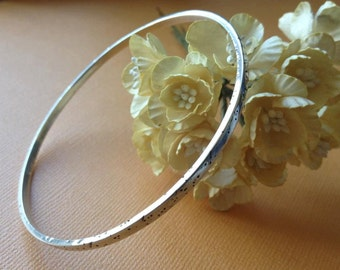Hand Forged and Distressed Sterling Silver Bangle