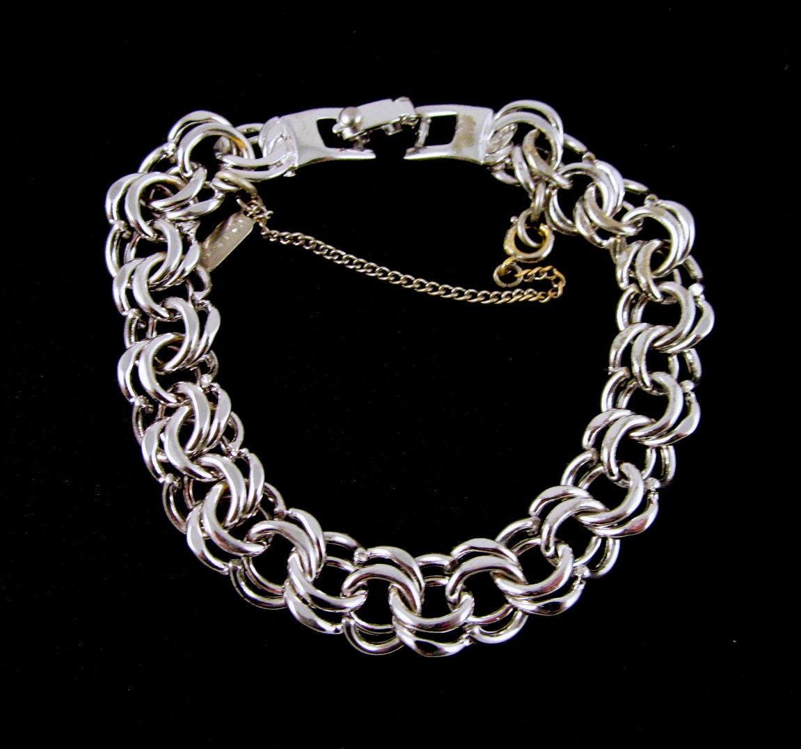 silver tone monet chanette charm bracelet 1960s