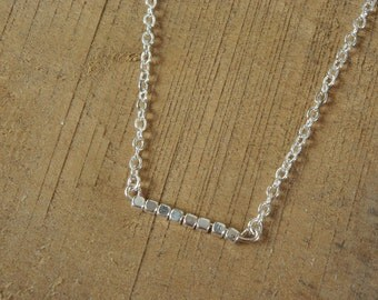 Necklace and square pearls