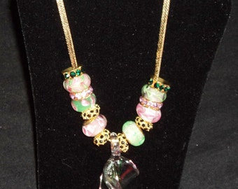 Pink, Burgundy, and Green Glass Beaded Necklace on a Vintage Gold Toned Chain