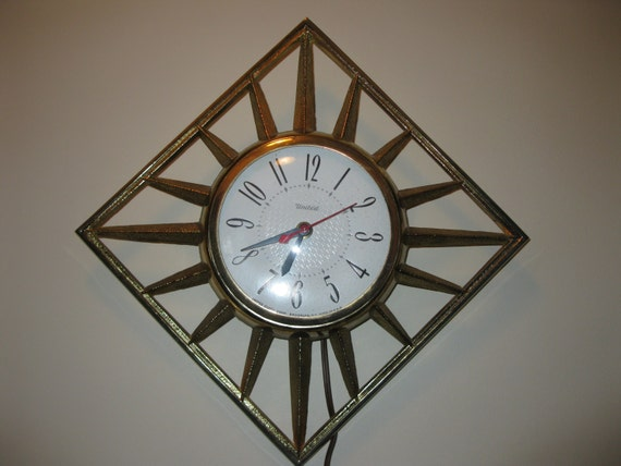 mid century modern united wall clock 1960s gold metal retro