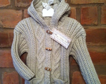 Gorgeous cable knit hooded Cardigan suitable for boy/girl available in sizes 0-3mths, 3-6mths, 6-12mths, 1-2 years