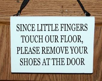 Since little fingers touch our floor please remove your shoes at the door wood sign/door hanger