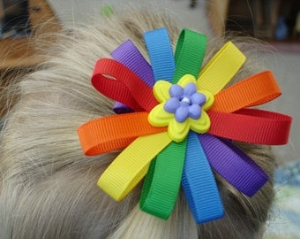 Daisy hair bow clip in rainbow colors with a flower button accent