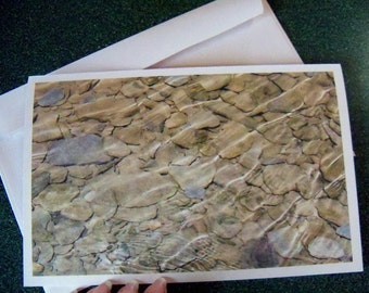 Ripples over stones note card