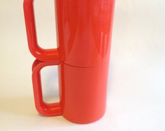 Red pair of Heller Maxmugs Designed by Massimo Vignelli