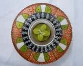 Art deco style tealight glass holder with green flower decorative candle