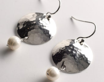 white pearl drop earring off silver hammered disc, june birthstone