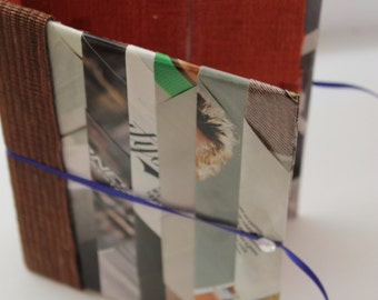 Hand made book binding, with recycled materials