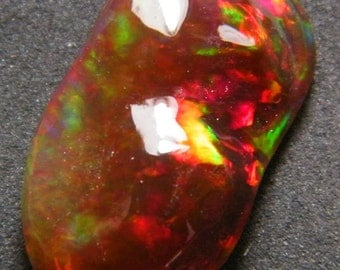 Beautiful mexican carved opal (E0041)
