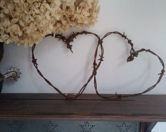 Entwined rusty barbed wire hearts home wedding decor