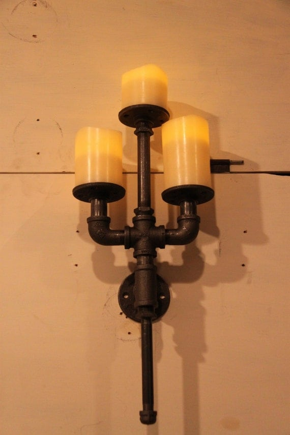 Items similar to Industrial pipe candle holder wall sconce trident on Etsy