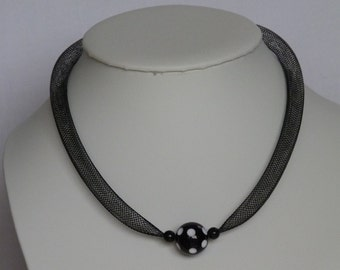 Black mesh tube necklace with 16mm black and white polka dot bead