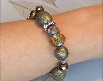 Bronze, amber, and tan stretch bracelet with charm