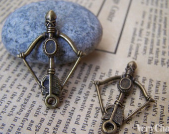 10 pcs of Antique Bronze Bow And Arrow Charms 25x37mm A1270