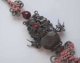 Antique silver, silk woman's decorative fashion tassel.