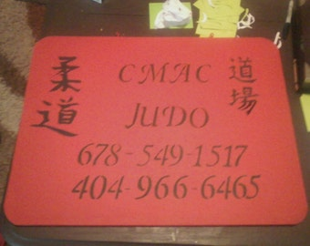 Wooden shanking sign made for a business.
