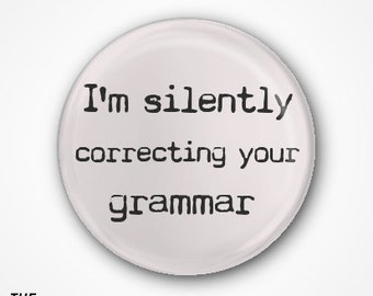 I'm silently correcting your grammar Pin Badge or Magnet. Available as a 2.5cm Badge or a 3.8cm Badge or Magnet.