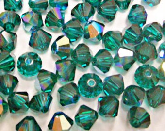 Swarovski Crystal Xilion 4mm Emerald AB color / 205 AB (100 pcs)