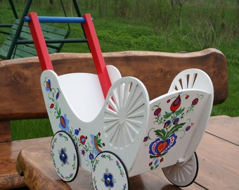 Doll stroller, painted in folk patterns