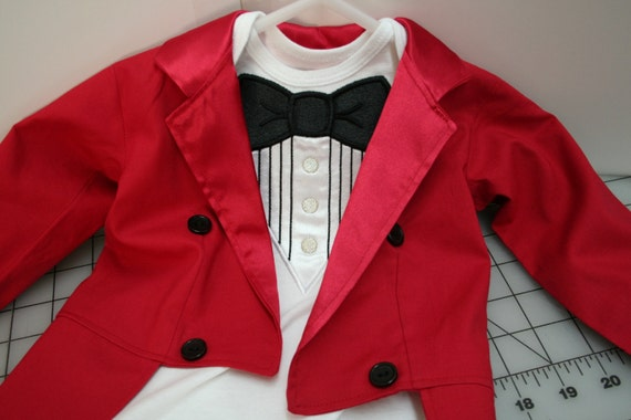 The Ringmaster Costume Premier includes a ringmaster jacket, a corset, boyshorts, a top hat headband, and a riding crop. Create Your Own Women's Ringmaster Costume lets you pick the ringmaster coat and accessories you need.