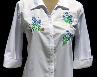 Spring in Texas means Texas bluebonnets! Embroidered bluebonnets adorn this 3/4 sleeve white cotton shirt.