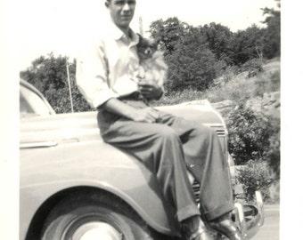 Vintage photo YOung Man Sits on CAr Holding Small Dog in His Arms 1941