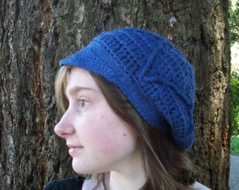 Hand-dyed navy blue crocheted newsie cap with a textured design