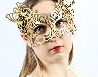 Rococo  leather mask in gold