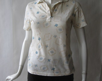 Navajo print polo shirt, in cream, light brown, and blue, early 1980's, medium