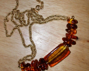 Necklace of Large Russian Amber Nuggets with Perfect Color Matched Glass Centerpiece on Goldtone Chain
