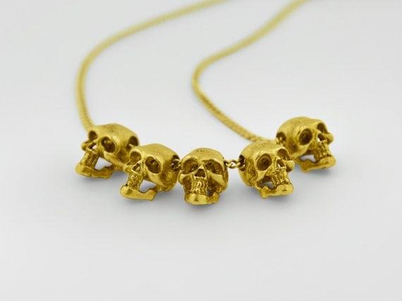 five gold skulls