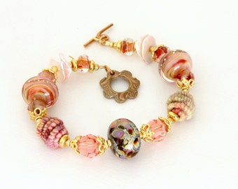 Peach Pink Lampwork Bead Bracelet. Artisan Glass and Fiber Bead Bracelet. Soft Pink Beaded Bracelet. Artisan Jewelry. Gifts For Her.