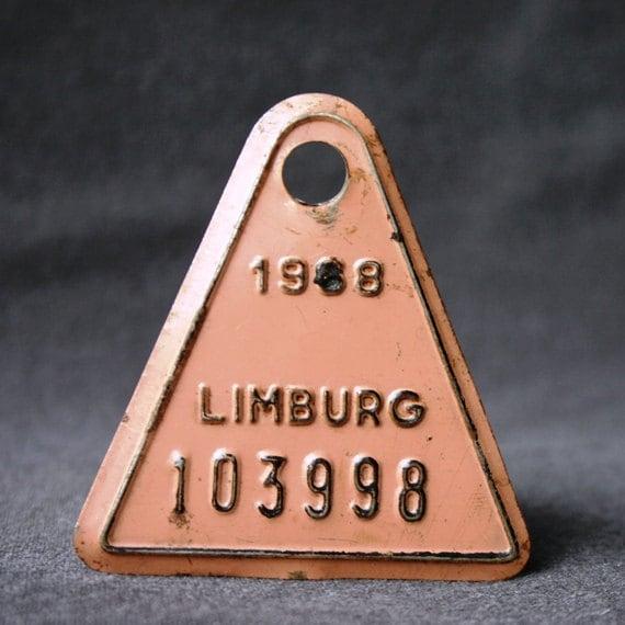 It was in 1968. Vintage old salmon orange bike license plate.